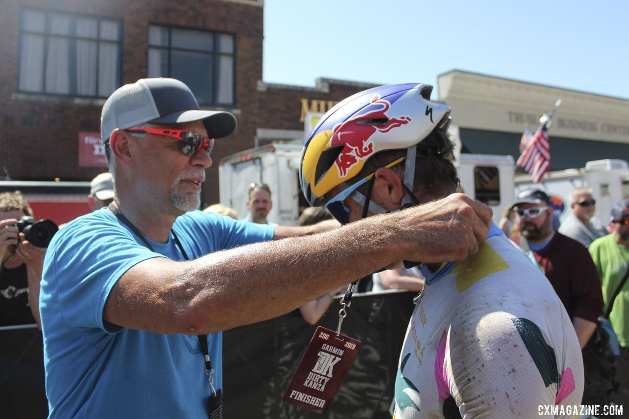 Jim Cummins gives Strickland his finisher's award. Men's Dirty Kanza 200 Gravel Race. © Z. Schuster / Cyclocross Magazine