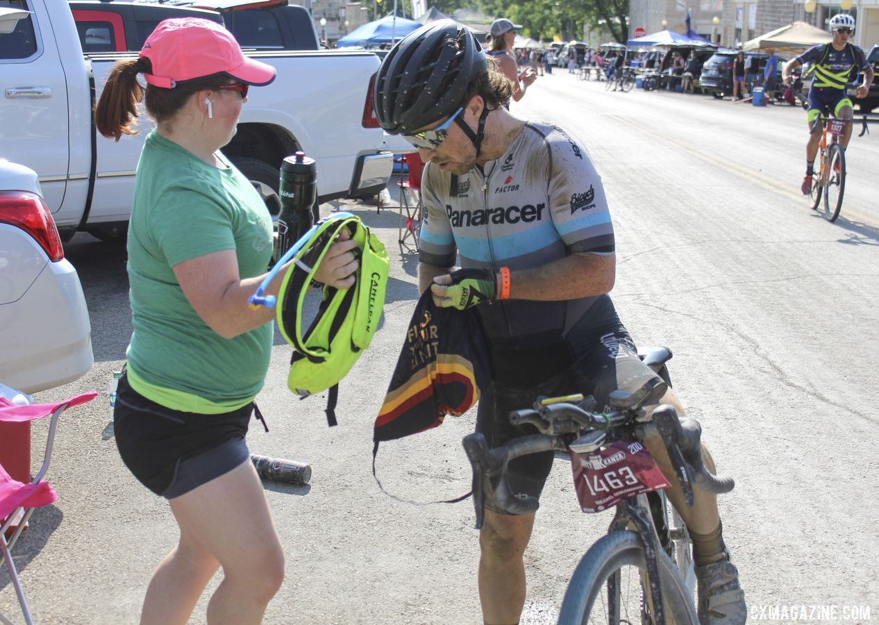 Jane Sencenbaugh helps Michael get a hydration pack and a new water bottle. 2019 Dirty Kanza 200, Panaracer / Factor p/b Bicycle X-Change Checkpoint 1. © Z. Schuster / Cyclocross Magazine