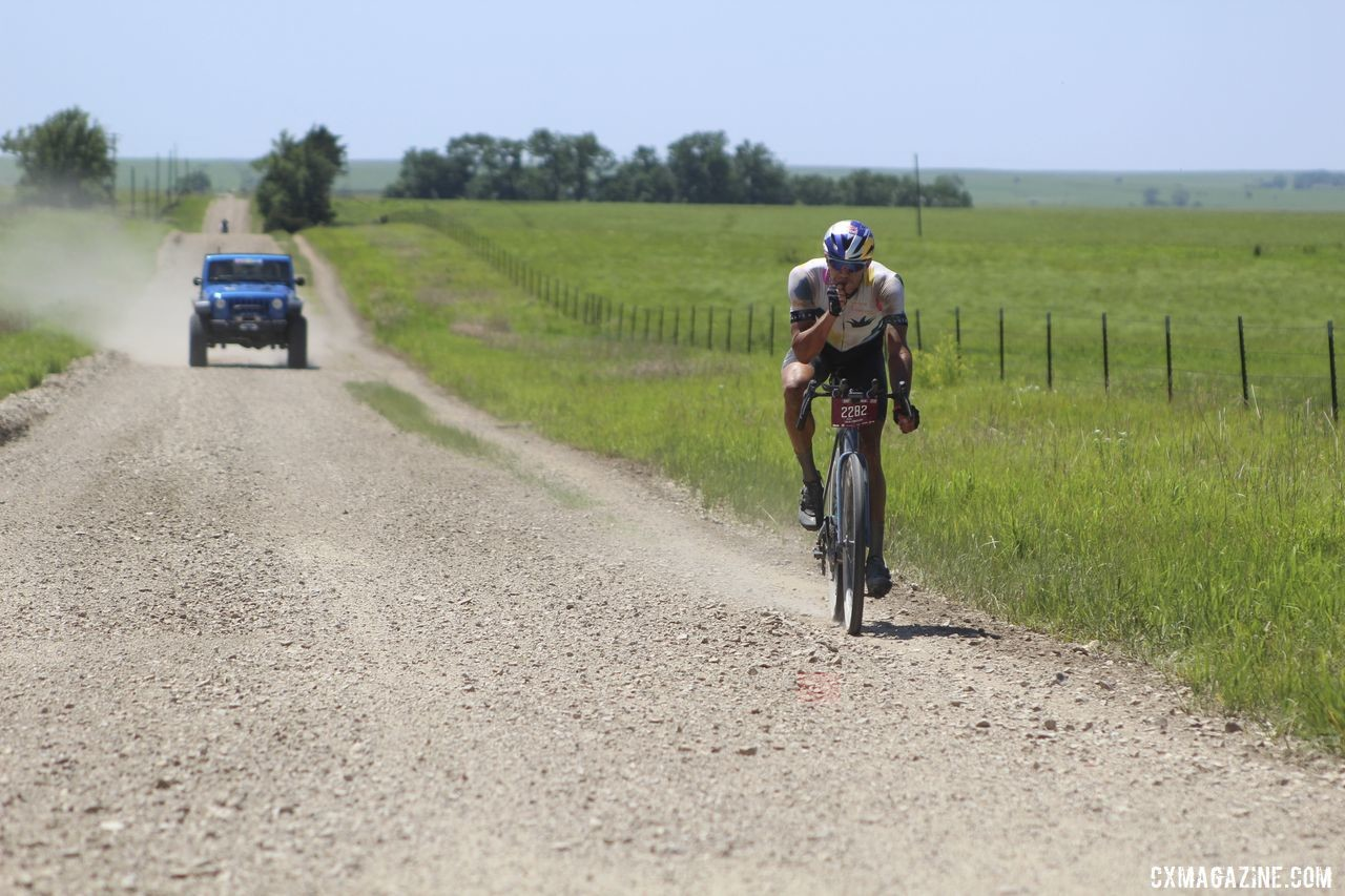 Colin Strickland snags some food during his 100-mile solo ride. 2019 Dirty Kanza 200 Gravel Race. © Z. Schuster / Cyclocross Magazine
