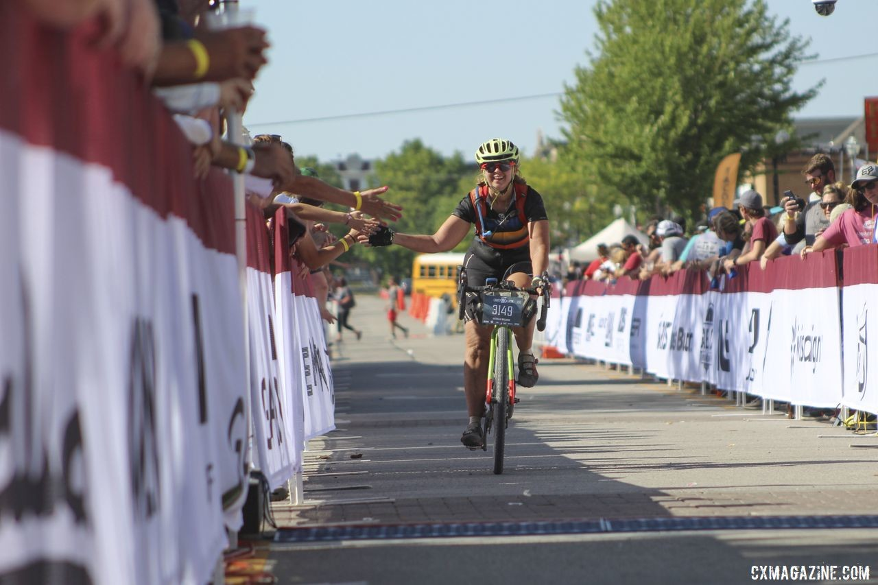 Finish line high fives aren't just for podium finishers at the Dirty Kanza. 2019 Dirty Kanza 200 Gravel Race. © Z. Schuster / Cyclocross Magazine