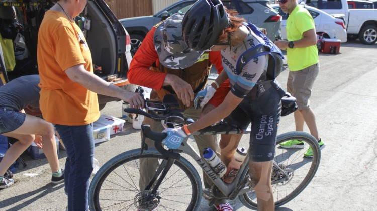 Dan Szokarski helps restock Takeshita's top tube bag while Becky Cummings helps hold her bike. 2019 Dirty Kanza 200, Panaracer / Factor p/b Bicycle X-Change Checkpoint 1. © Z. Schuster / Cyclocross Magazine