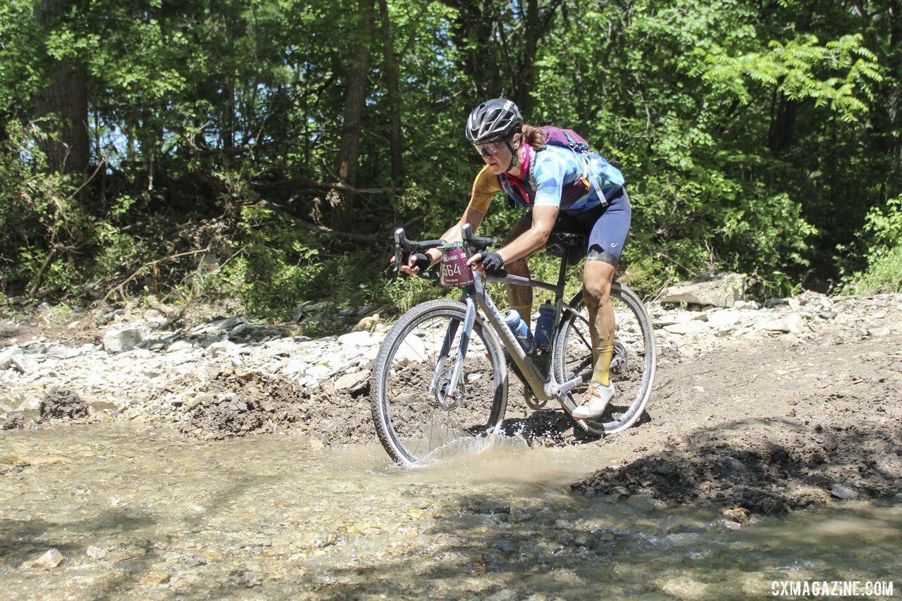 Olivia Dillon splashes through Little Ford with the lead. 2019 Women's Dirty Kanza 200 Gravel Race. © Z. Schuster / Cyclocross Magazine