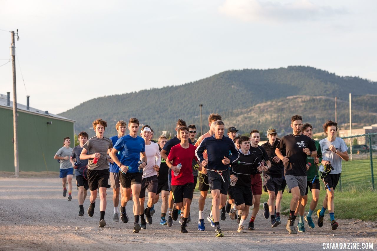 Campers run across campus to the morning training session. 2019 Men's Montana Cross Camp. © Tom Robertson