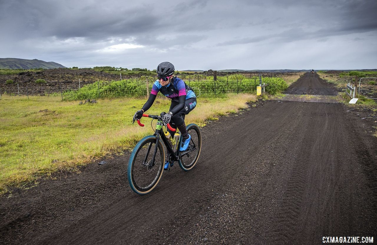 Carrie Bax passes through a cattle guard. The Rift Gravel Race 2019, Iceland. © Snorri Thor / Lauf