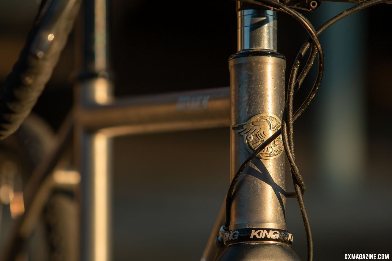 Whether splashed with mud or sun, the Merlin Sandstone titanium gravel bike should remain corrosion free. The head badge is just one detail that differentiates Merlin from its sister brand, Dean. © Cyclocross Magazine