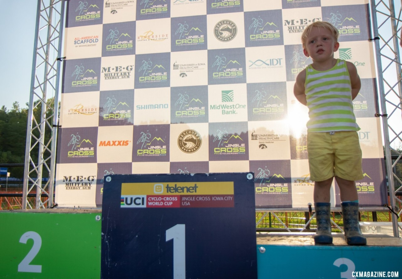 A young volunteer awaits the pro men podium on Sunday. 2019 Jingle Cross. © A. Yee / Cyclocross Magazine