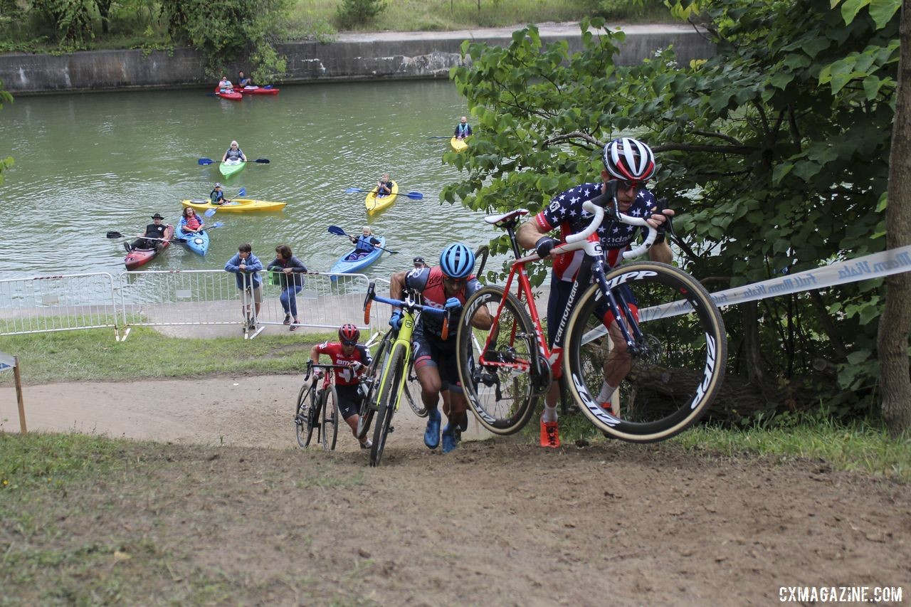 "Stephen Hyde charges up ""The Wall"" as kayakers watch behind. 2019 Rochester Cyclocross Day 2. © Z. Schuster / Cyclocross Magazine"
