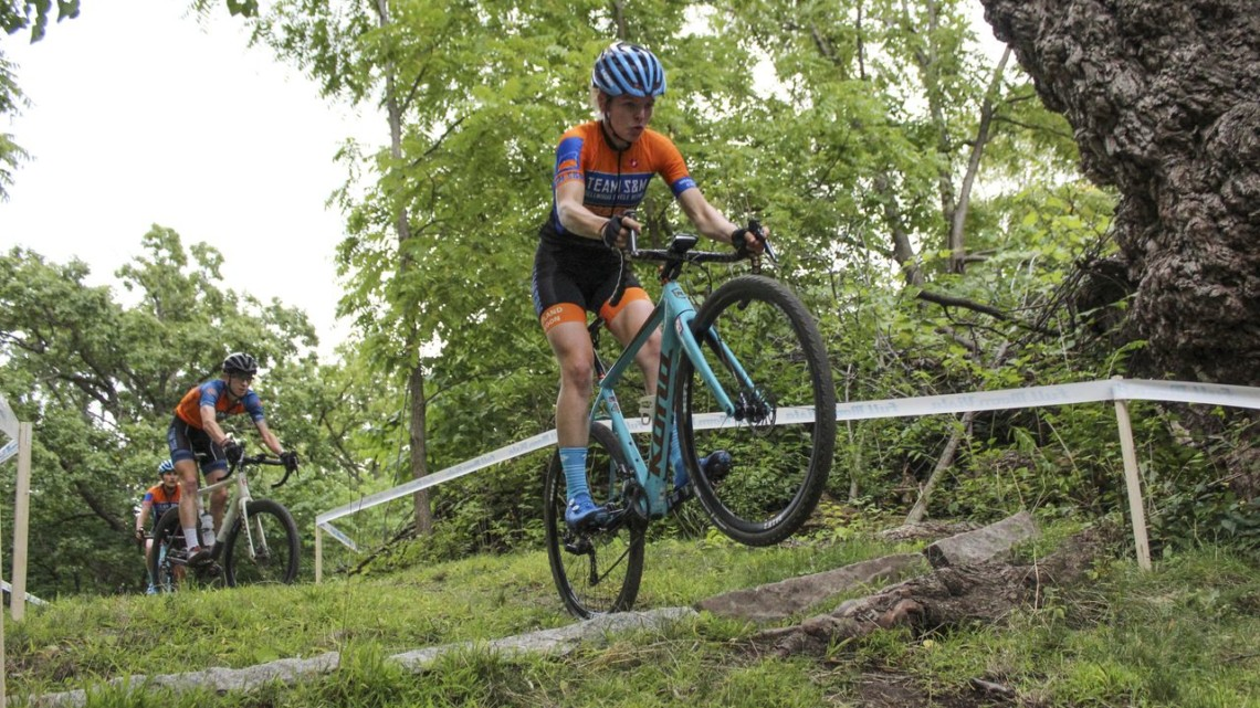Clara Honsinger sends it over the granite block into a descent. 2019 Rochester Cyclocross Friday Pre-Ride. © Z. Schuster / Cyclocross Magazine