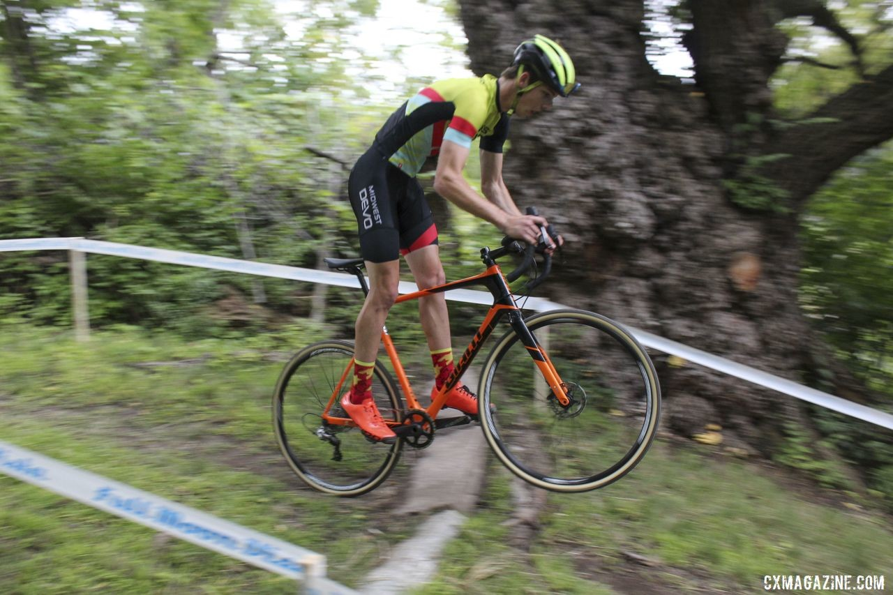 A Midwest Devo rider gets rad over the granite slab. 2019 Rochester Cyclocross Friday Pre-Ride. © Z. Schuster / Cyclocross Magazine