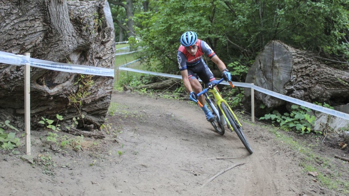 Kerry Werner passes through the entrance to Double Trouble, which was formed by cutting a downed willow tree. 2019 Rochester Cyclocross Day 2, Sunday. © Z. Schuster / Cyclocross Magazine