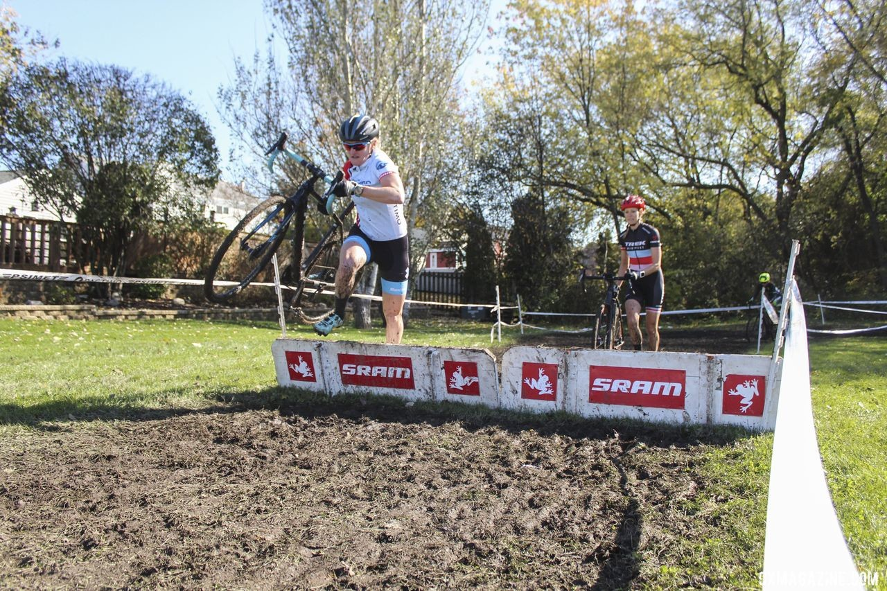Erin Feldhausen and April Beard hit the barriers together in chase of Sydney Guagliardo. 2019 Sunrise Park Cyclocross, Chicago Cross Cup. © Z. Schuster / Cyclocross Magazine