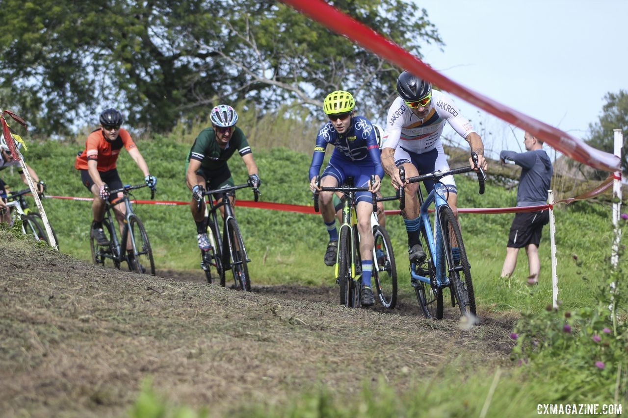 Tim Strelecki leads with Peter Swinand into one of the first muddy corners. 2019 CCC Hopkins Park CX at Indian Lakes. © Z. Schuster / Cyclocross Magazine