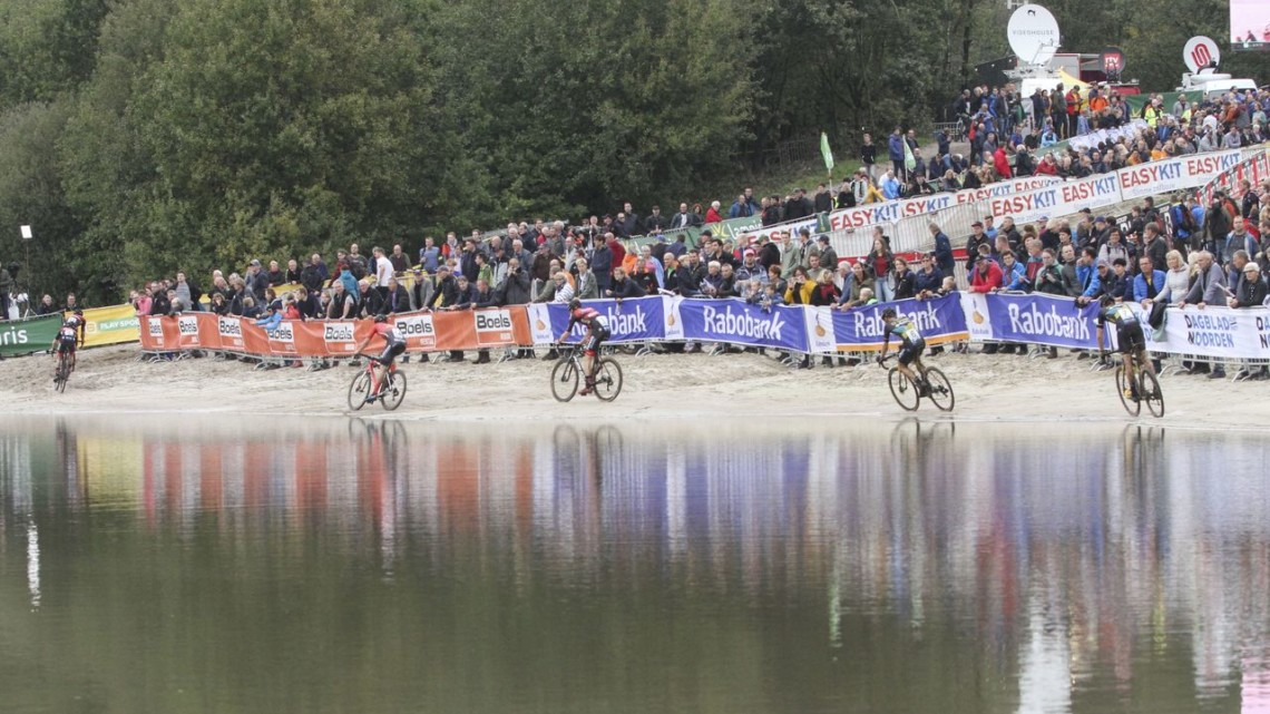 Riders pass along the Gieten lake. 2019 Superprestige Gieten. © B. Hazen / Cyclocross Magazine