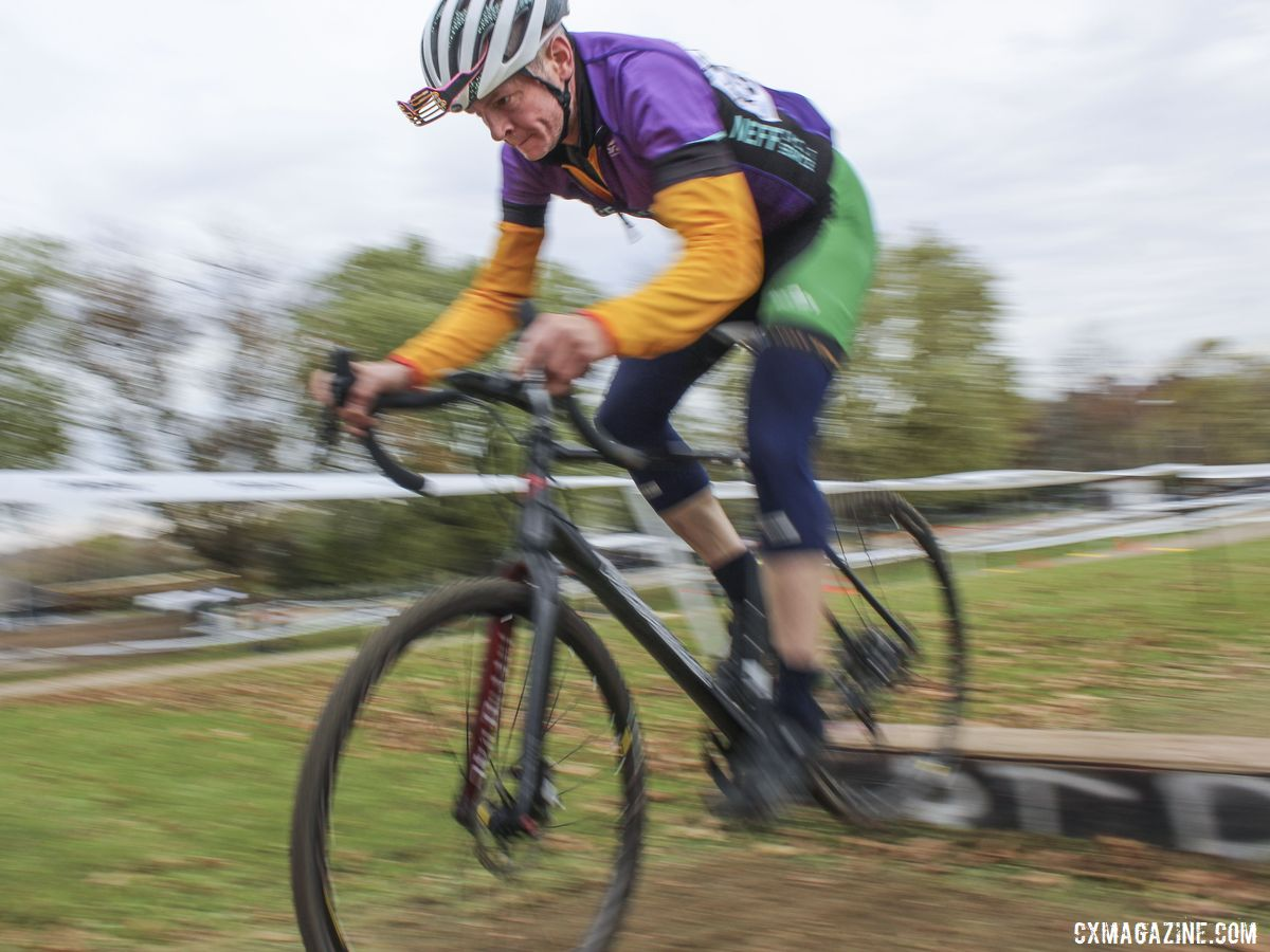 Patrick Flannery, clad in the many colors of Team Neff Cycle Service, hops one of the coffins. 2019 Cross Fire Halloween Race, Wisconsin. © Z. Schuster / Cyclocross Magazine