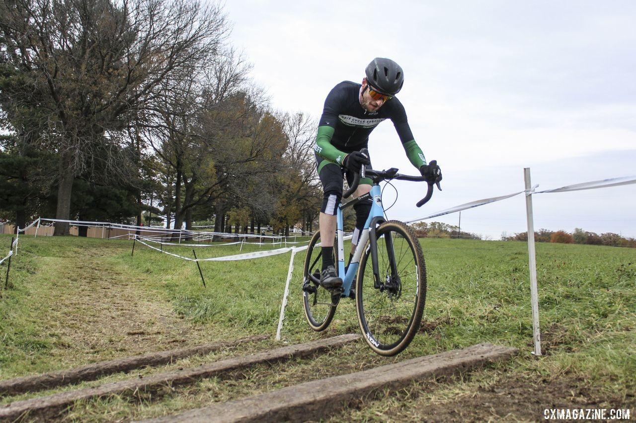 Isaac Neff hops the railroad ties. 2019 Cross Fire Halloween Race, Wisconsin. © Z. Schuster / Cyclocross Magazine