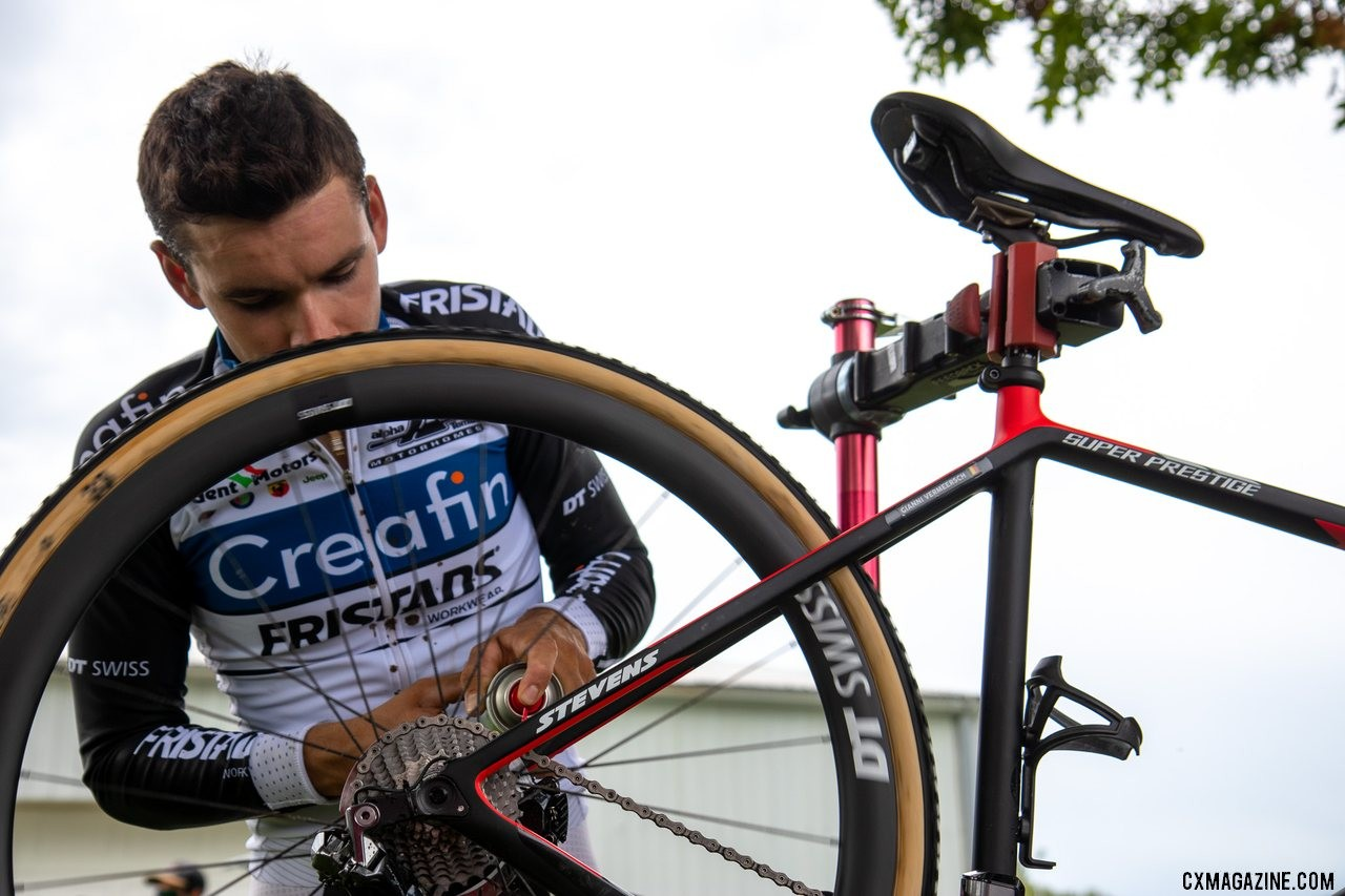 Cleaning the disc brakes and rotors before Jingle Cross. Flying solo in Iowa and Waterloo, Gianni Vermeersch had to do much of his own bike work. © A. Yee / Cyclocross Magazine