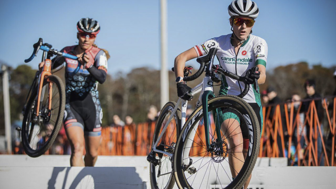Katie Clouse and Rebecca Fahringer hit the barriers together. 2019 Really Rad Festival of Cyclocross Day 1. © Angelica Dixon