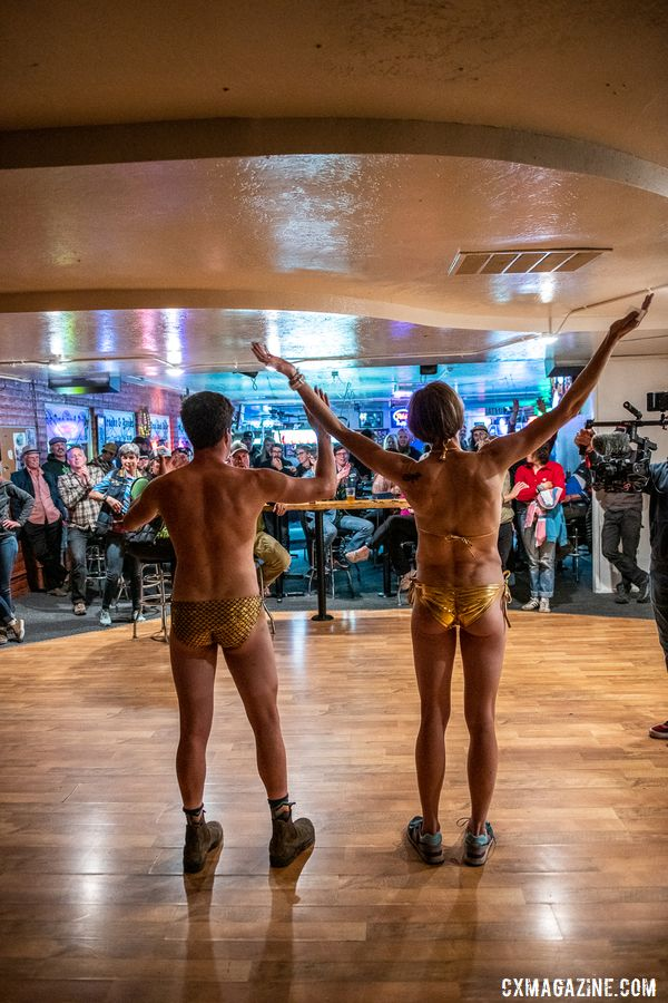 The King and Queen greet the crowd in the traditional golden bikinis at the after party. 2019 Singlespeed Cyclocross World Championships, Utah. © Jeff Vander Stucken