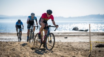 Mens A 35+ winner Ryan Odell and the lead group charge across the beach of Granite Bay. 2019 Sacramento CX Granite Beach, California. © Jeff Vander Stucken