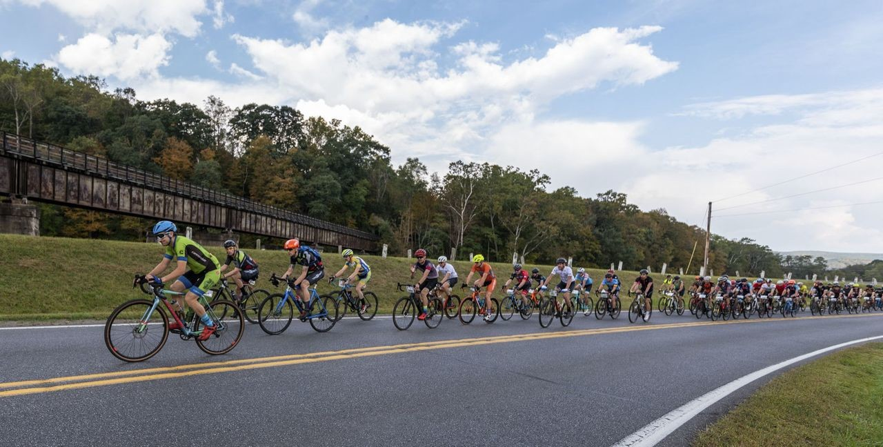 Ridrs roll toward the first climb while on pavement. photo: The Quick & The Dead GG