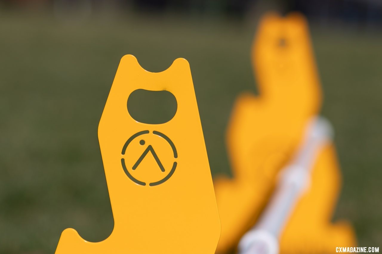The Up.Bike portable barriers help facilitate hand-ups with a handy bottle opener. © A. Yee / Cyclocross Magazine