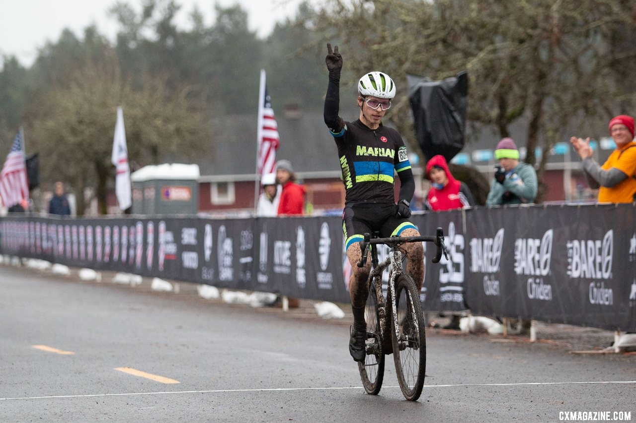 A two-finger victory salute for Caleb Swartz's second Cyclocross National Championship. Collegiate Varsity Men. 2019 Cyclocross National Championships, Lakewood, WA. © A. Yee / Cyclocross Magazine