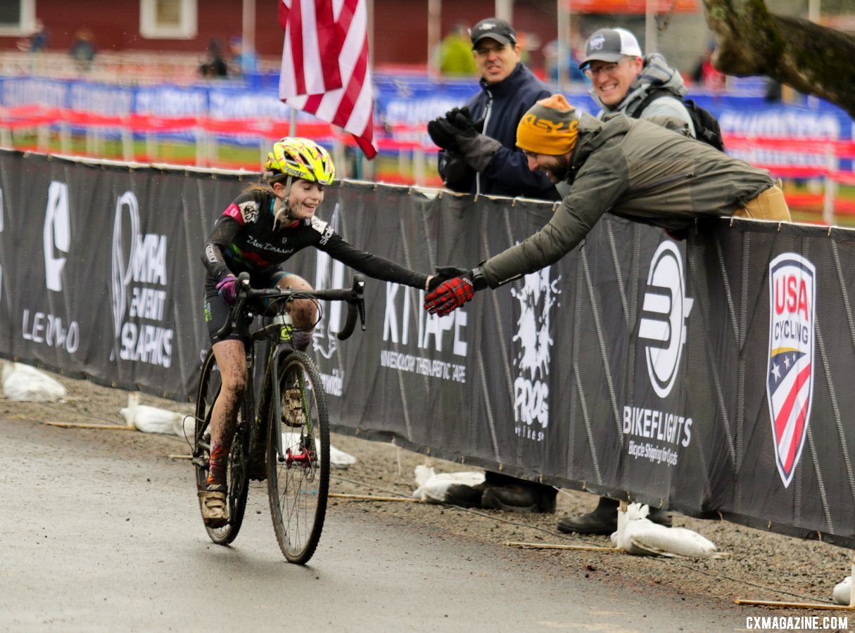 Local rider Keaghlan Robinson hi-fives her dad, Steve, as she nears the finish line in second place. Junior Women 11-12. 2019 Cyclocross National Championships, Lakewood, WA. © D. Mable / Cyclocross Magazine