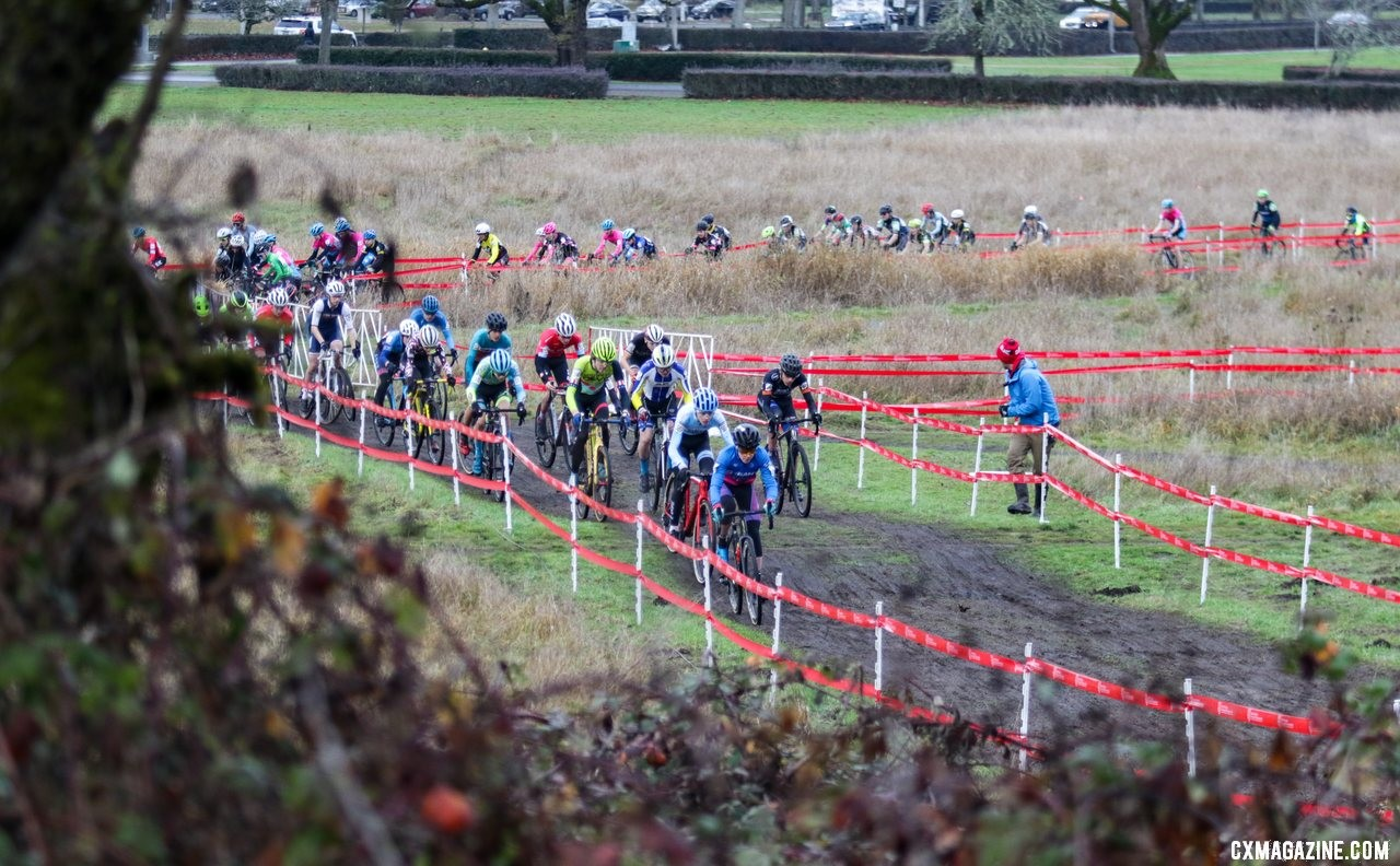 Benjamin Crismon leads a large group of riders to the base of the first climb. Junior Men 15-16. 2019 Cyclocross National Championships, Lakewood, WA. © D. Mable / Cyclocross Magazine
