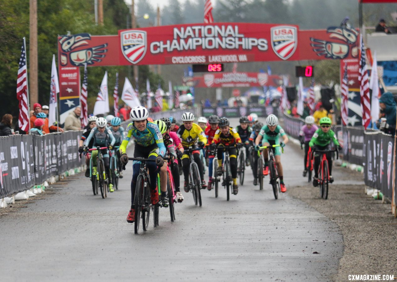 Rowan Child takes the holeshot, leading a field of 30 riders onto the muddy course. Junior Men 11-12. 2019 Cyclocross National Championships, Lakewood, WA. © D. Mable / Cyclocross Magazine
