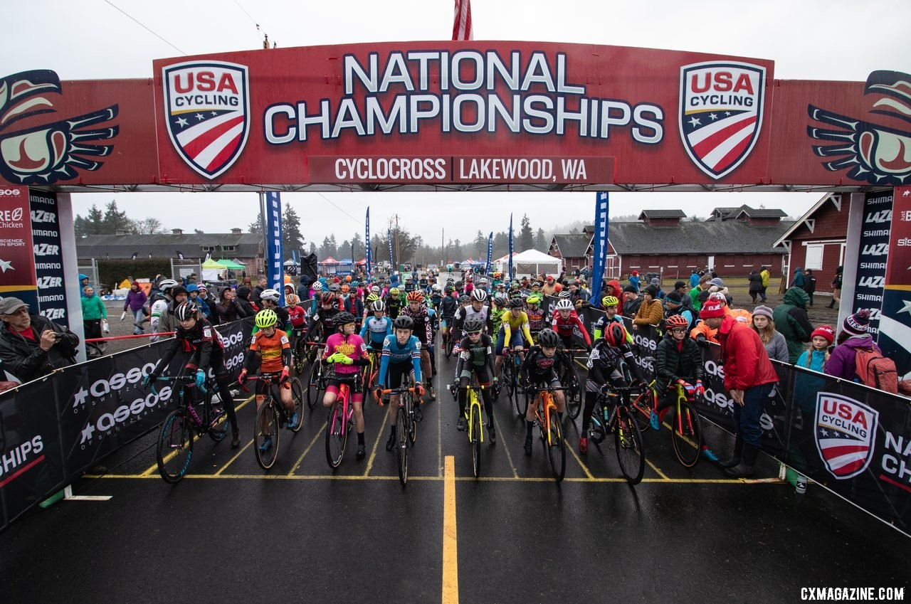 The field of 62 Junior Men 13-14 year old riders waits for the green light on the mornings first championship race. Junior Men 13-14. 2019 Cyclocross National Championships, Lakewood, WA. © A. Yee / Cyclocross Magazine