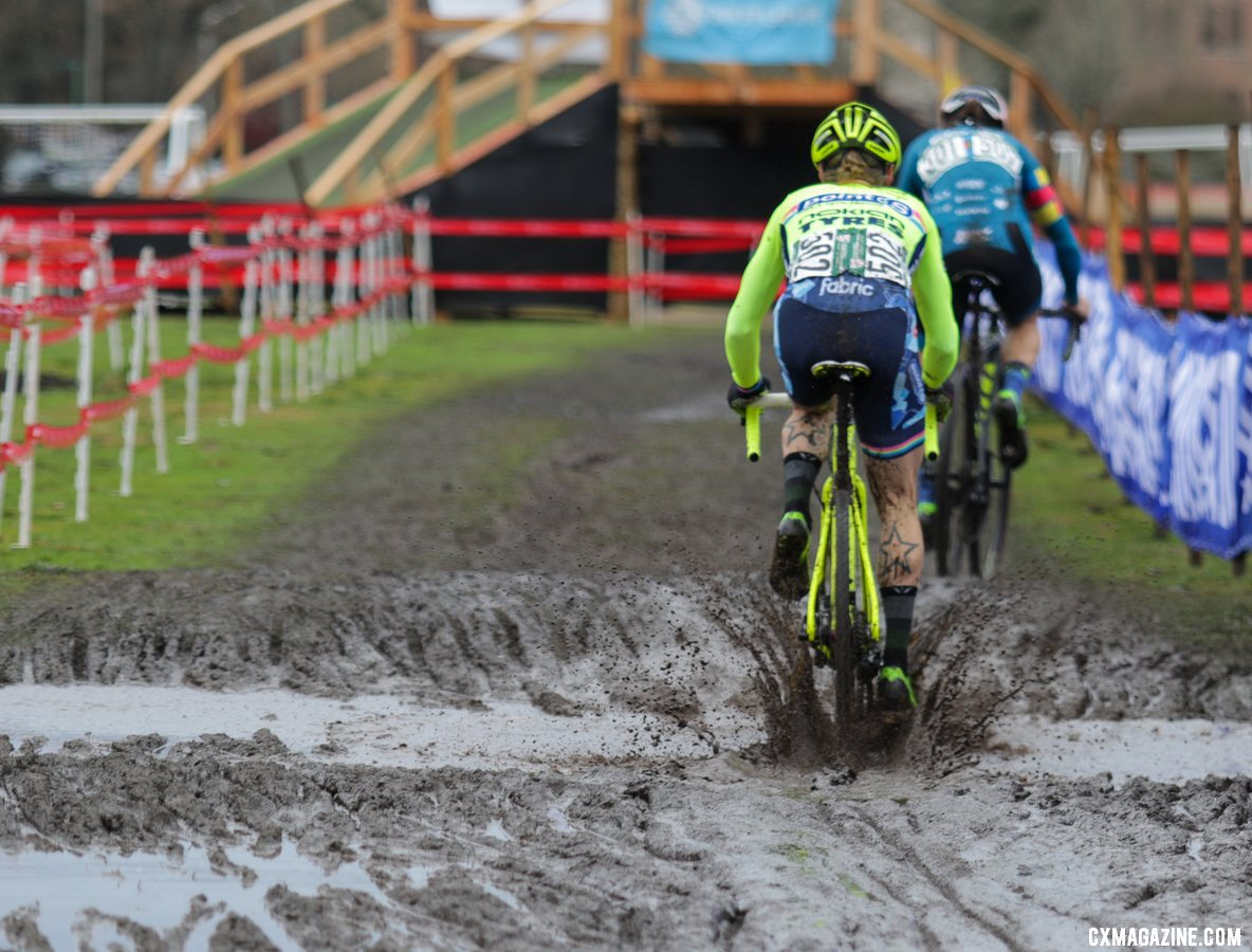 Molly Cameron splashes through the mud as he chases Jake Wells. Masters Men 40-44. 2019 Cyclocross National Championships, Lakewood, WA. © D. Mable / Cyclocross Magazine
