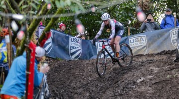 Melissa Barker slides under the disco lights on a slippery descent. Masters Women 45-49. 2019 Cyclocross National Championships, Lakewood, WA. © D. Mable / Cyclocross Magazine