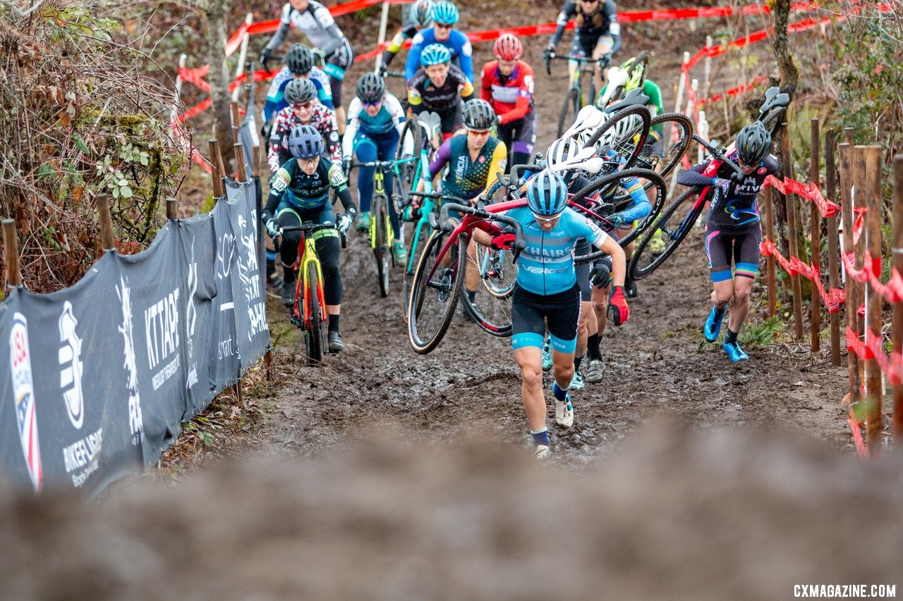 With the entire field in her wake, Elizabeth Sheldon leads up the first climb. The Masters Women 50-54 hit the run-up for the first time. 2019 Cyclocross National Championships, Lakewood, WA. © A. Yee / Cyclocross Magazine