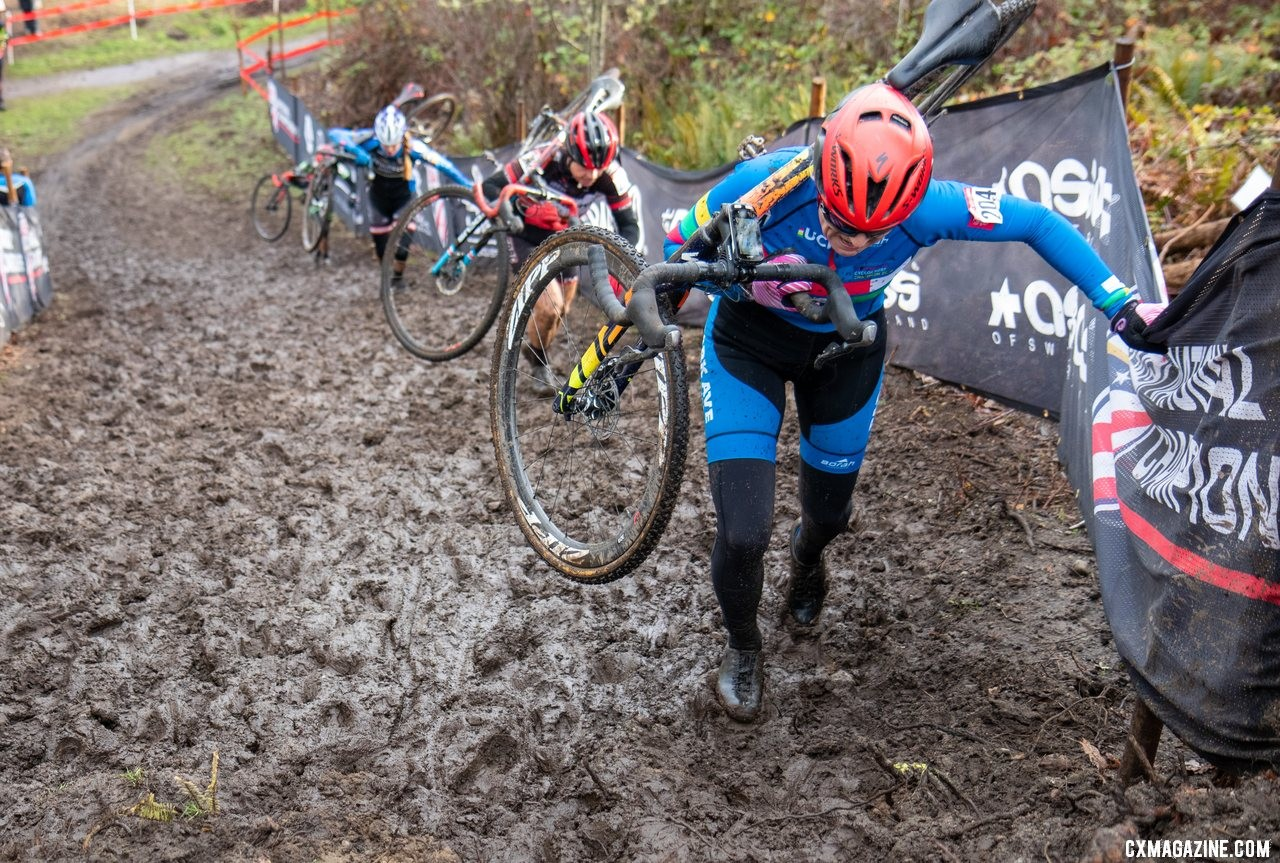 Wearing her PanAm Champion jersey, Merit Sheffield leads a small group up the second climb on the first lap of the Masters Women 55-59 race. Masters Women 55-59. 2019 Cyclocross National Championships, Lakewood, WA. © A. Yee / Cyclocross Magazine
