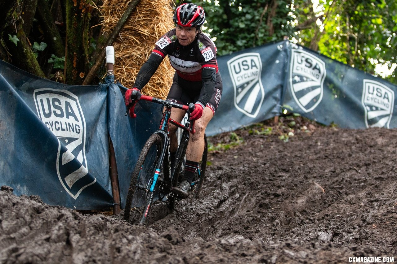 Patricia Murray slices through a deep run on her way down one of the steep muddy hills on the course. Masters Women 55-59. 2019 Cyclocross National Championships, Lakewood, WA. © A. Yee / Cyclocross Magazine