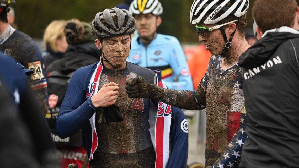 U.S. riders share a fist bump after their race. U23 Men, 2019 Namur UCI Cyclocross World Cup. © B. Hazen / Cyclocross Magazine