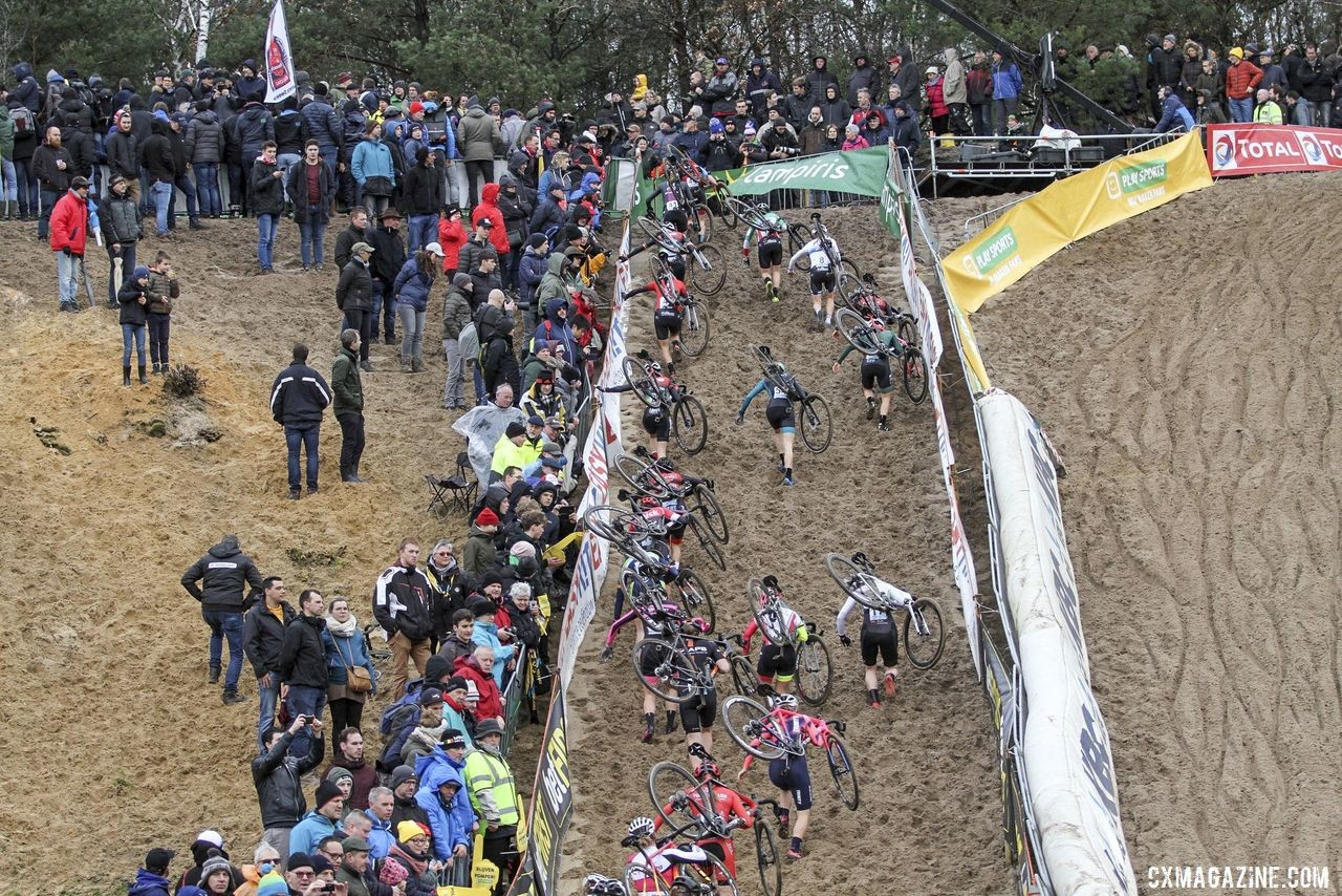 The Elite Women scramble up the steep wall of The Pit. 2019 Superprestige Zonhoven. © B. Hazen / Cyclocross Magazine