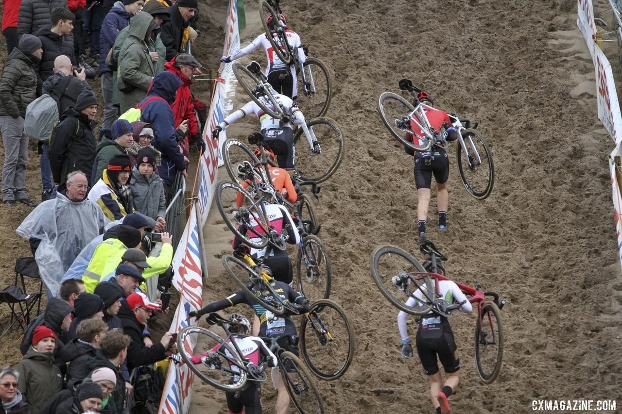 The Elite Women scramble up the De Kuil wall in the first lap. 2019 Superprestige Zonhoven. © B. Hazen / Cyclocross Magazine