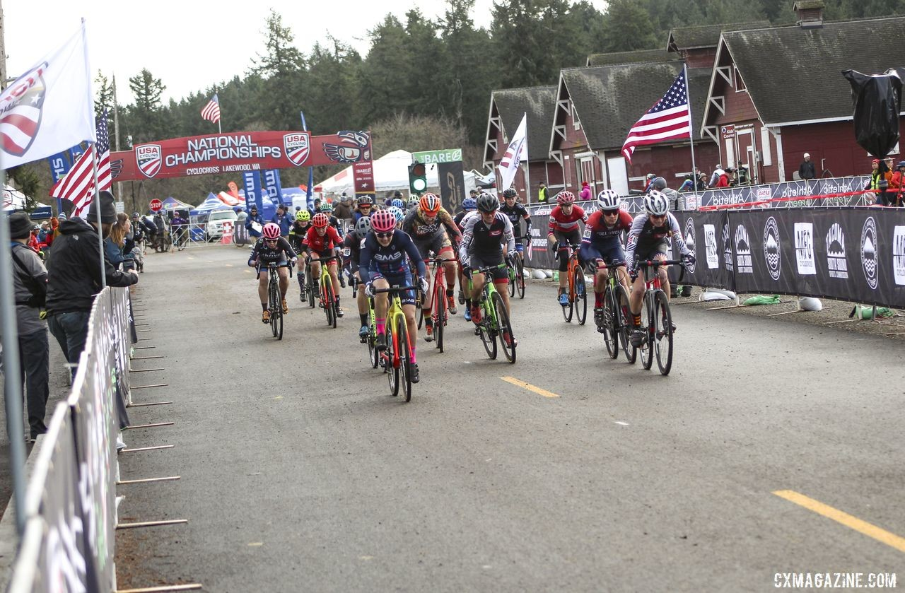 The Masters Women 45-49 field races down the holeshot straight. © Cyclocross Magazine