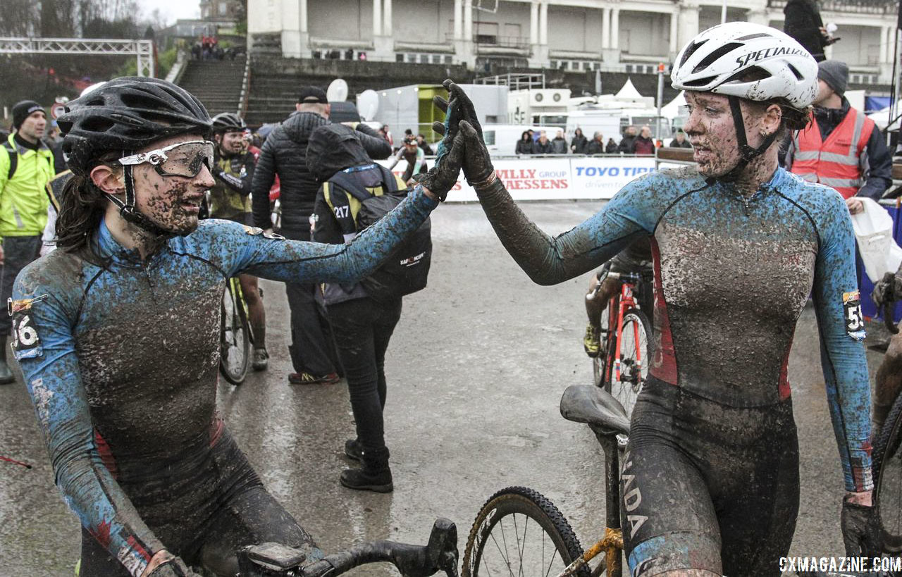 Ruby West and Magdeleine Vallieres Mill share a high five after their race. 2018 World Cup Namur. © B. Hazen / Cyclocross Magazine