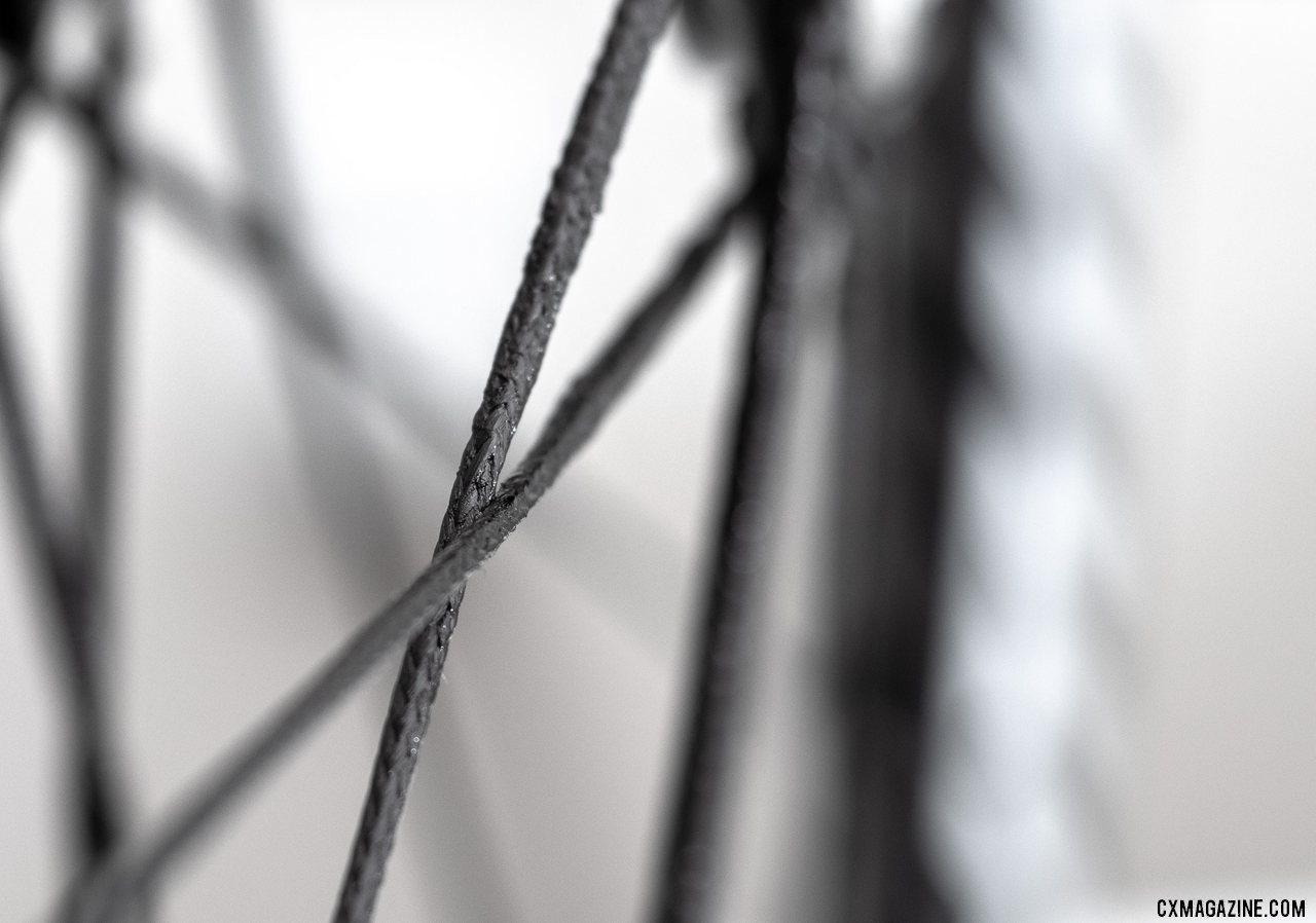Berd's polymer spokes claim 12 times the strength to weight ratio of steel spokes. Atomik's Ultimate Berd carbon tubeless wheels with Berd polyethylene spokes. © Cyclocross Magazine