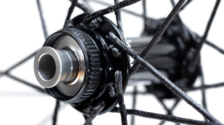 Berd spokes are still laced and crossed in a traditional fashion. Industry Nine Centerlock hubs feature compatibility with a variety of axle systems. Atomik's Ultimate Berd carbon tubeless wheels with Berd polyethylene spokes. © Cyclocross Magazine