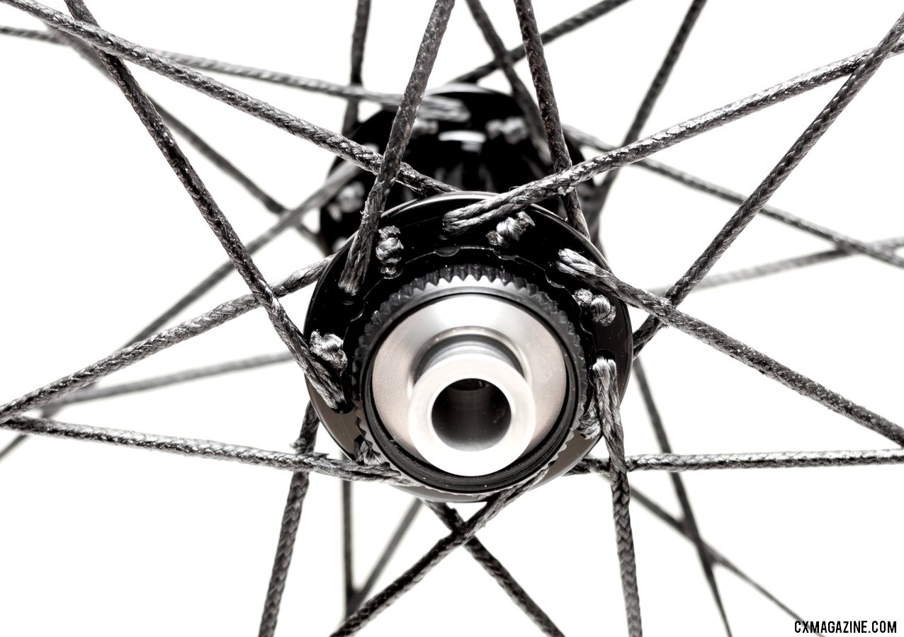 Berd spokes are pulled through the hub flange and secured with a rod, which acts as a stop. Atomik's Ultimate Berd carbon tubeless wheels with Berd polyethylene spokes. © Cyclocross Magazine