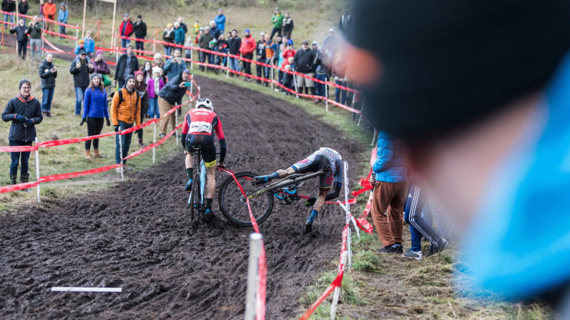 Gage Hecht and Kerry Werner get caught in the course tape on lap two at the 2019 Cyclocross Nationals. Photographer Mike Albright captured the sequence. © Mike Albright