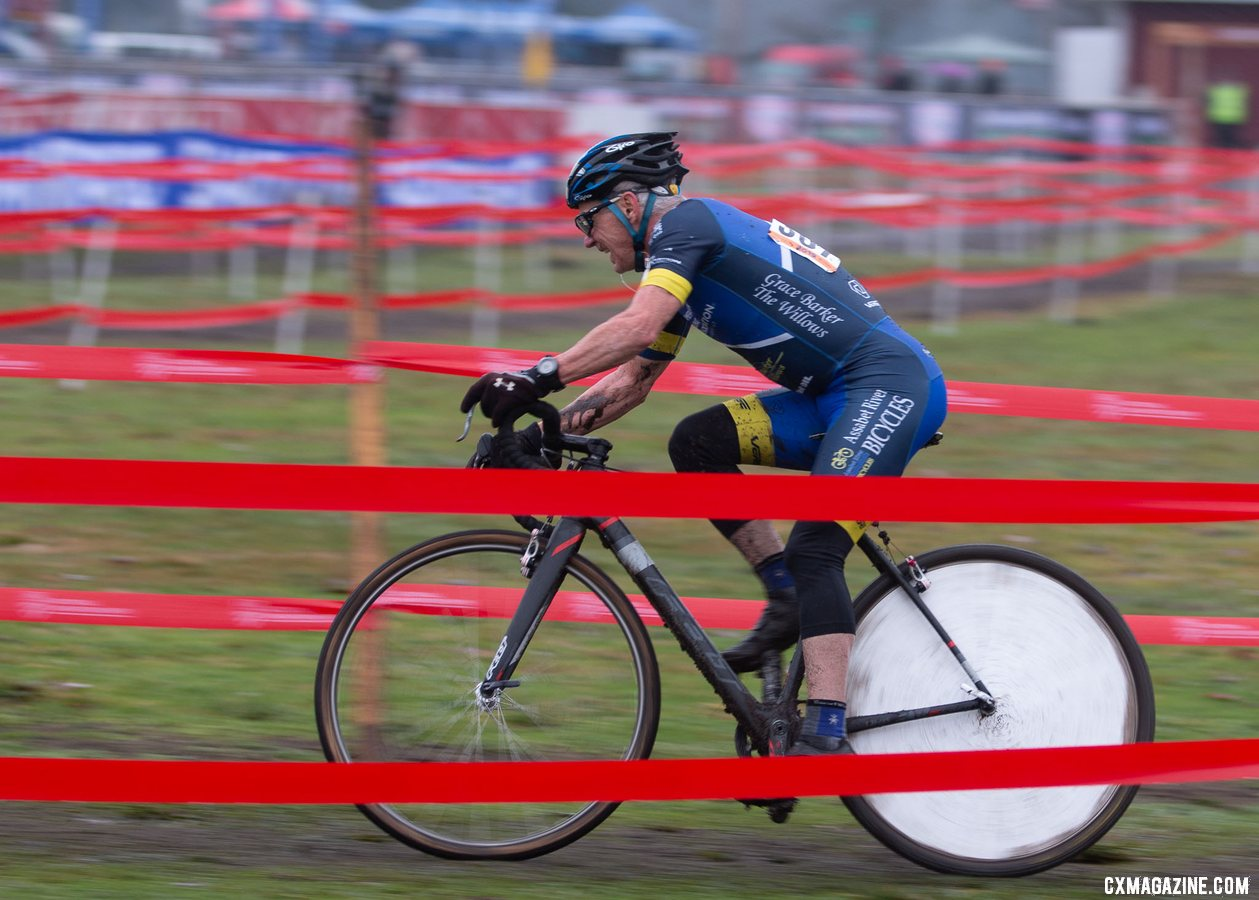 Paul Curley and his iconic spoke cover. Masters Men 65-69. 2019 Cyclocross National Championships, Lakewood, WA. © A. Yee / Cyclocross Magazine