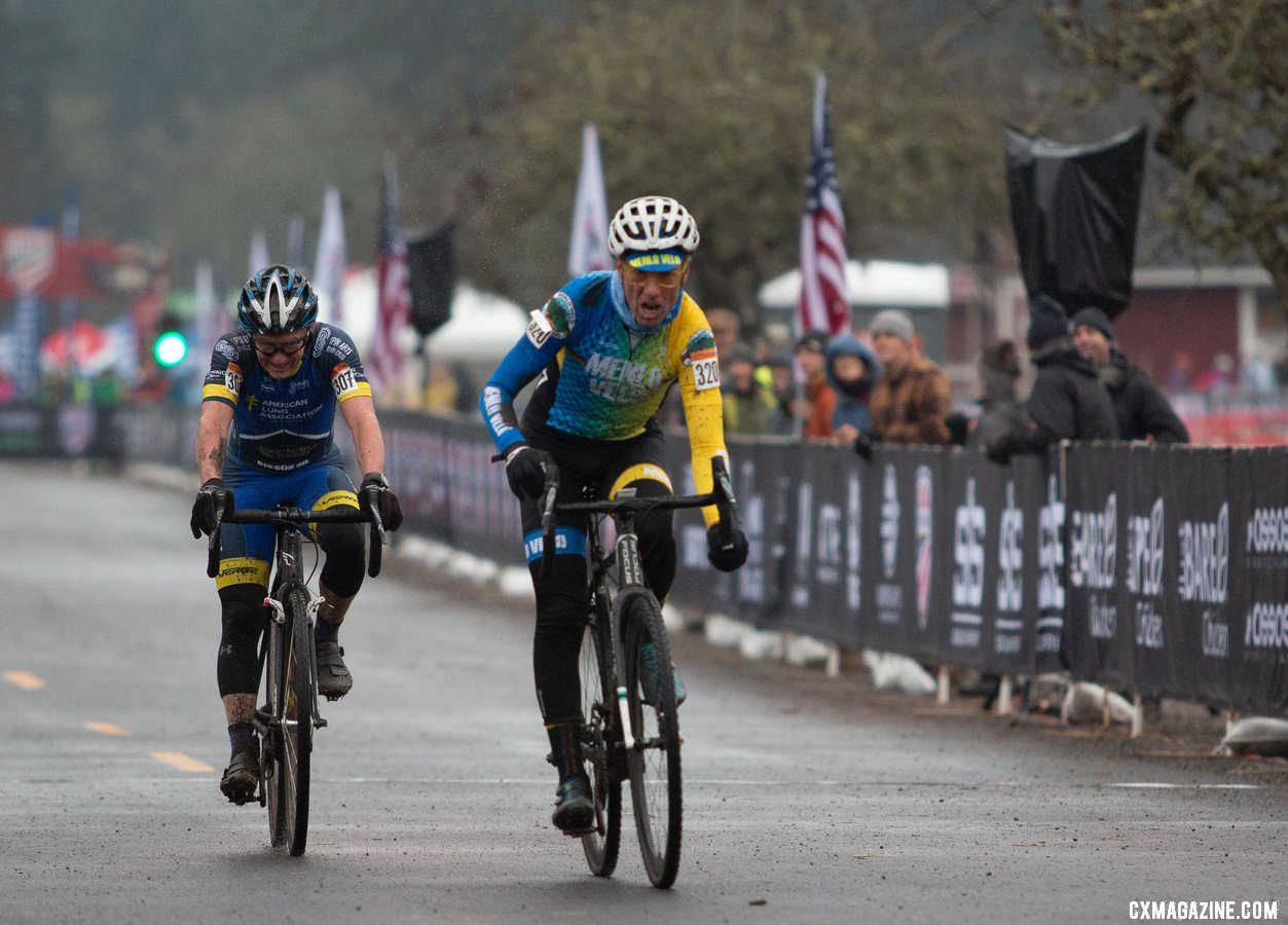 Paul Curley and George Smith had a battle for the ages. Masters Men 65-69. 2019 Cyclocross National Championships, Lakewood, WA. © A. Yee / Cyclocross Magazine