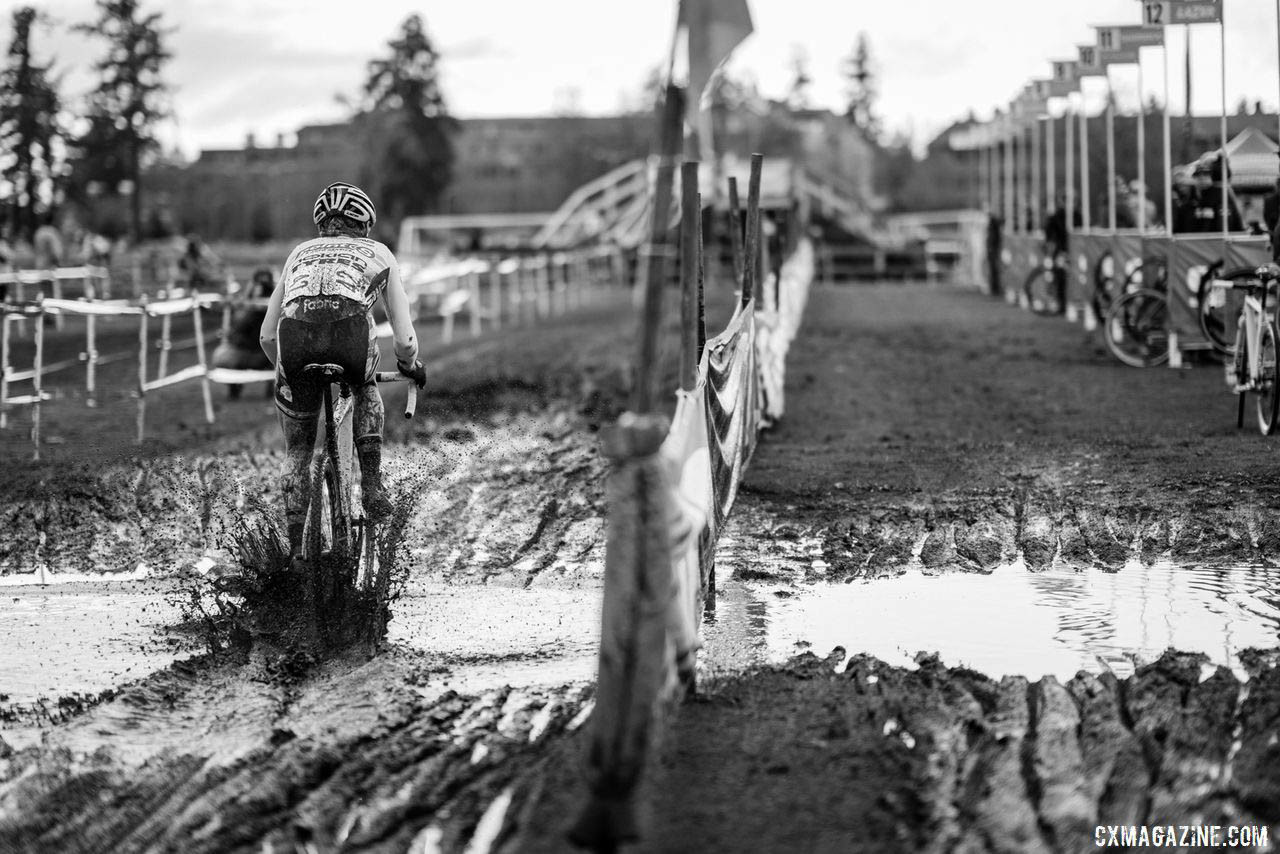 Power washers caused a few puddles near the pit - Molly Cameron shown blasting through on Sunday. 2019 Lakewood U.S. Cyclocross Nationals. © Drew Coleman