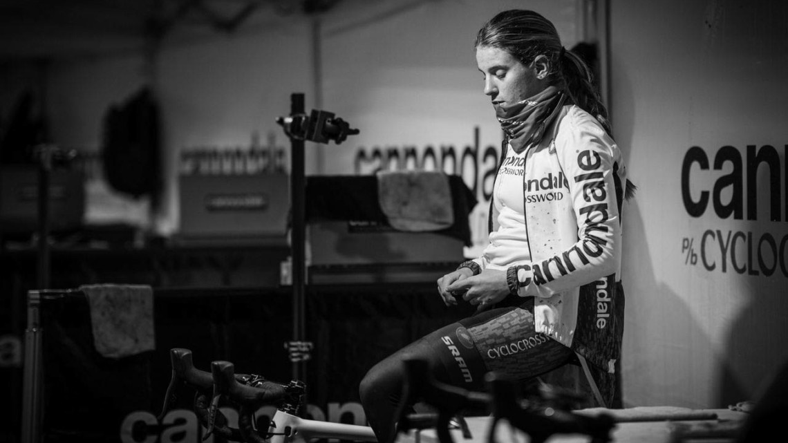 n a quiet moment, Katie Clouse warms up in the trainer. She would take the win on Sunday in the Women's U23 race.2019 Lakewood U.S. Cyclocross Nationals. © Drew Coleman