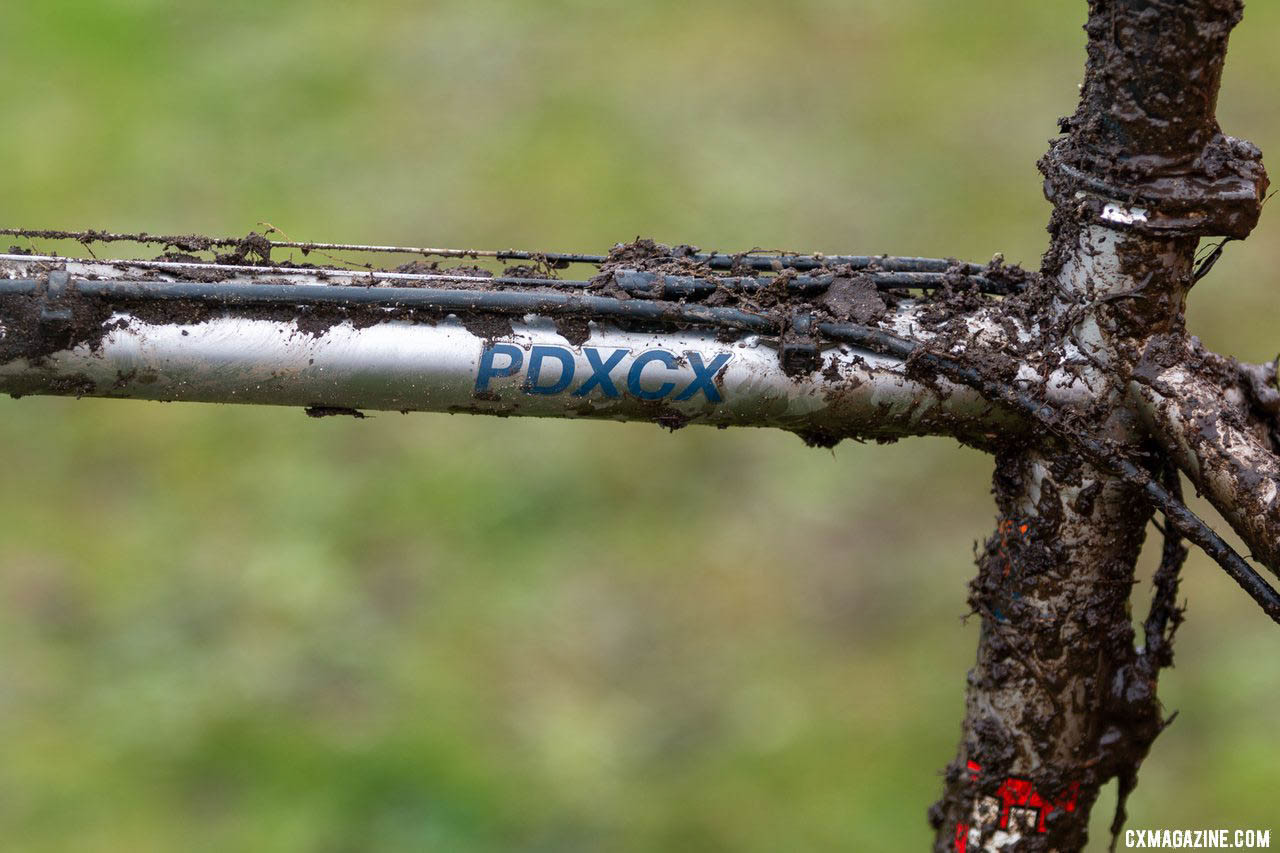 Mud obscures another look at the patented Cable Clip System that gives riders a choice of how many cable stops they want or need on the top tube. of Jack Spranger's Jr 15-16 winning Sage PDXCX cyclocross bike. 2019 Cyclocross National Championships, Lakewood, WA. © A. Yee / Cyclocross Magazine