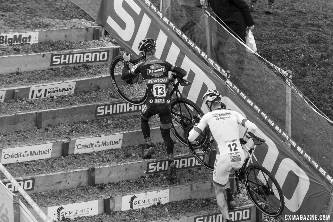 Iserbyt and Aerts head up the stairs at the beginning of the last lap. 2020 World Cup Nommay, France. © B. Hazen / Cyclocross Magazine